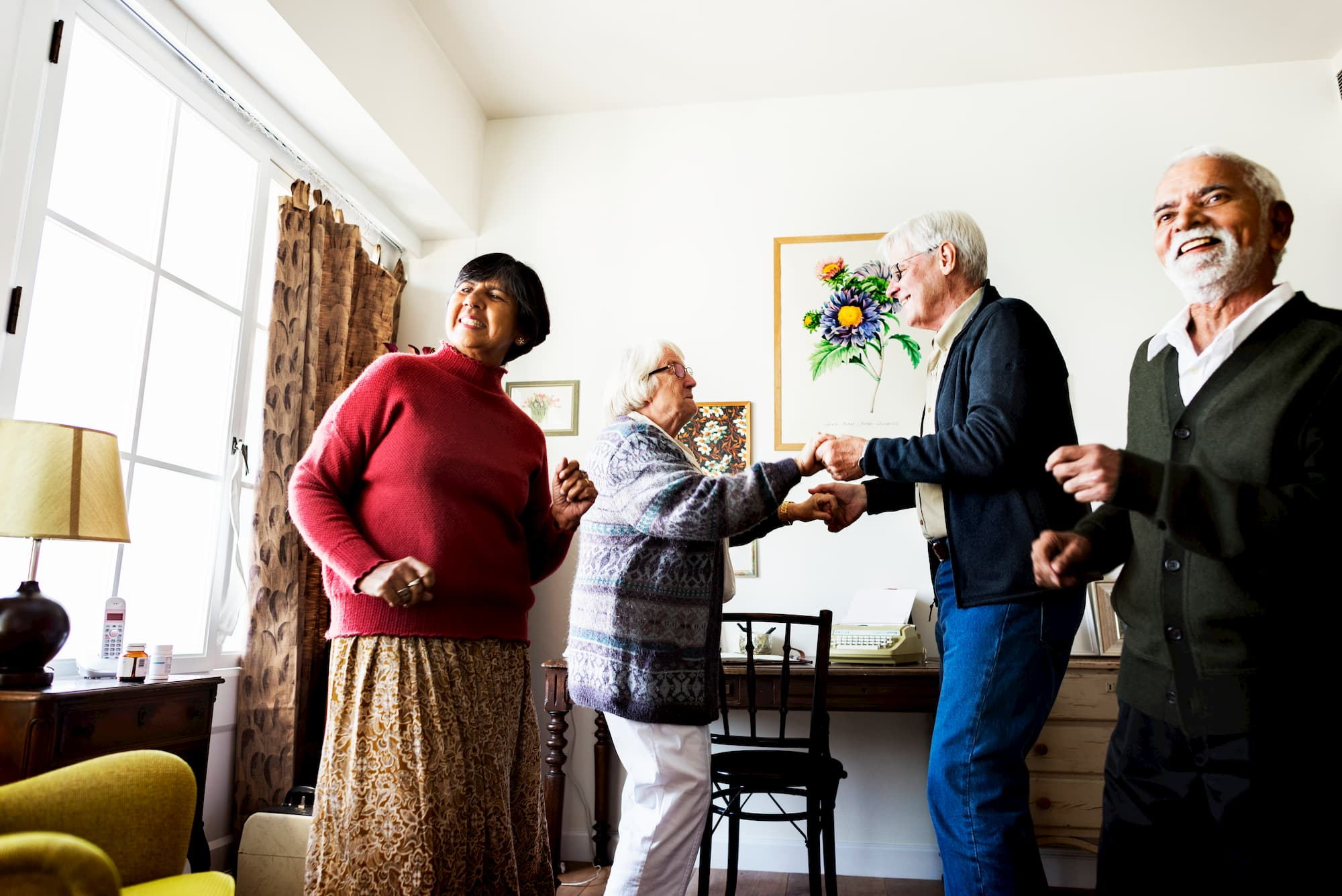 senior friends dancing at home